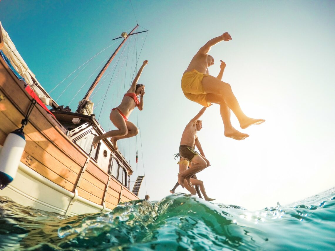 boat rentals malta boatcare trading malta. adults jumping from boat to sea